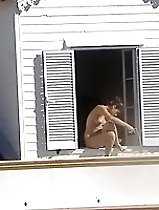 Brazilian babe nude in window
