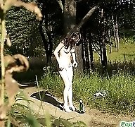 Beautiful kitty plays watersports on a quiet forest glade