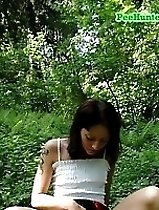 Gorgeous teeny sits down for a piss in the woods