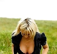 Gorgeous busty blonde filmed pissing on a field
