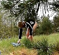 Kinky young pisser gets all naked in the woods