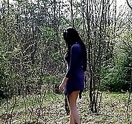 Curvaceous chick empties her bladder in the woods