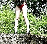 Girl takes off red panties and pees in the woods