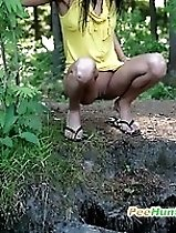 Watch a skinny exotic brunette piddle in the woods