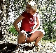 Petite blonde teen pisses up a storm in bushes