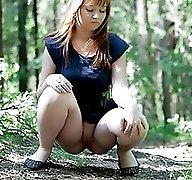 Chubby young busty squats down to tinkle a little