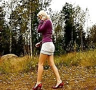 Blonde with tattooed legs pees near forest edge