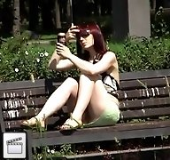 Voyeur upskirt pussy of brunette girl drinking beer